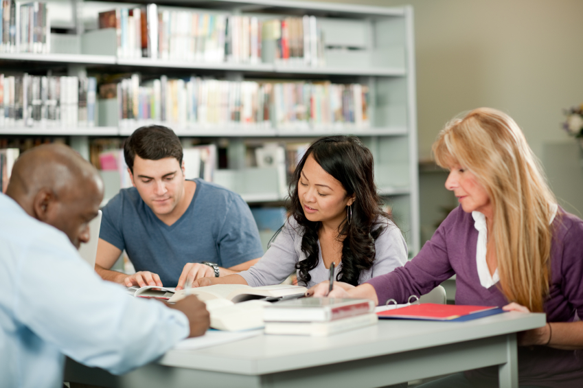 Adult education - adult students in a library.